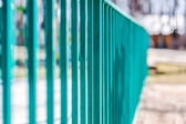 Green metal fence — Stock Photo