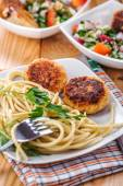 Meat patties and pasta with parsley — Stock Photo