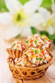 Few cakes in wicker basket — Stock Photo