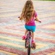 Little girl riding bicycle — Stock Photo #54218699