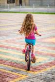 Little girl riding bicycle — Stock Photo