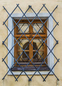 Window with wrought iron bars — Stock Photo