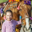 Little girl with festive horse — Stock Photo #55861977