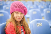 Little smiling girl in red beret — Stock Photo