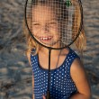 Happy little girl holding tennis racket — Stock Photo #55923843