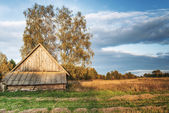 Rural landscape with old wooden — Stock Photo
