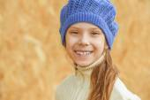 Little girl in blue beret laughing — Stock Photo