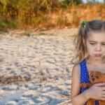 Little sad girl holding teddy bear — Stock Photo #58040235