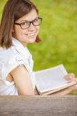Portrait young pretty girl glasses book — Stock Photo