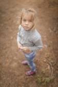 Little sad girl in sweater — Stock Photo
