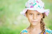Beautiful little girl in hat — Stock Photo