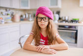 Little girl with glasses and red beret — Stock Photo
