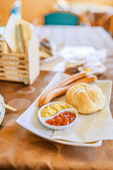 Sausages, mustard, ketchup and bun — Stock Photo
