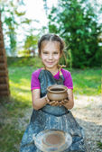 Little girl with pot — Stock Photo