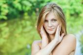 Portrait of young beautiful blond woman — Stock Photo