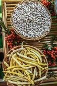 White beans in wicker basket — Stock Photo