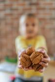 Little girl with walnuts — Stock Photo