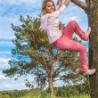 Girl is turned round tree — Stock Photo #61872669