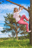 Girl is turned round tree — Stock Photo