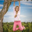 Girl is turned round tree — Stock Photo #62981281