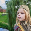 Small girl in Soviet military uniforms — Stock Photo #63284559