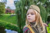 Small girl in Soviet military uniforms — Stock Photo
