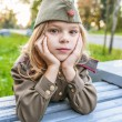 Small girl in Soviet military uniforms — Stock Photo #64030945