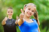 Two teenage girls shows hand sign ok — Stock Photo