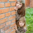 Small girls in Soviet military uniforms — Stock Photo #64343445
