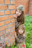Small girls in Soviet military uniforms — Stock Photo