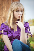 Portrait of girl in violet blouse — Stock Photo