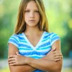 Sad teenage girl in blue blouse — Stock Photo #64518071