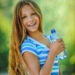 Teenage girl with water bottle — Stock Photo #64518239