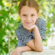 Little girl in striped dress — Stock Photo #64700635