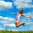 Young woman close-up jumping — Stock Photo #67757509