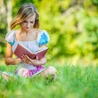 Portrait of beautiful woman holding book — Stock Photo #68151489