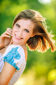 Portrait young cheerful woman peeps — Stock Photo