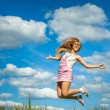 Young woman close-up jumping — Stock Photo #68200029