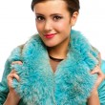 Beautiful girl in warm fur coat with fur — Stock Photo #68783283