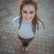Girl stand on square tile — Stock Photo #69101593