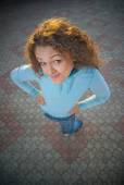 Girl stand on square tile — Stock Photo
