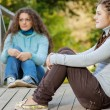 Two young and beautiful girls at banisters — Stock Photo #69341687