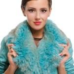 Beautiful girl in warm fur coat with fur — Stock Photo #69610507