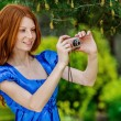 Red-haired smiling young woman photographed — Stock Photo #69928253