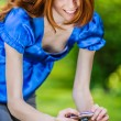 Red-haired smiling young woman photographed — Stock Photo #69928599