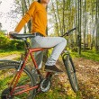 Beautiful girl riding bicycle — Stock Photo #71848055