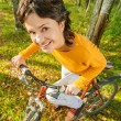 Beautiful girl riding bicycle — Stock Photo #71848113