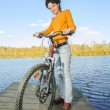 Beautiful girl riding bicycle — Stock Photo #71848273