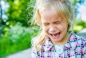 Sad little girl crying — Stock Photo