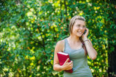 Young woman speaks by phone — Stock Photo